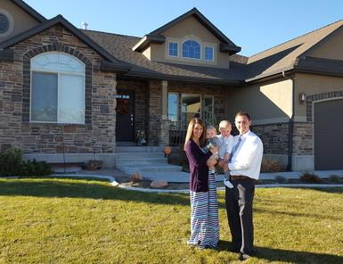 Happy physician assistant homeowner